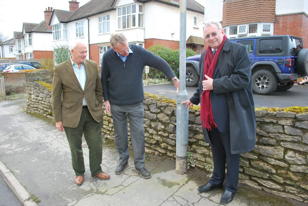 Frank Myers, Chairman of Herefordshire Community Foundation, Colin Taylor, local resident and flood warden, and Michael Holland point to the mark on a lamppost showing the depth the water reached